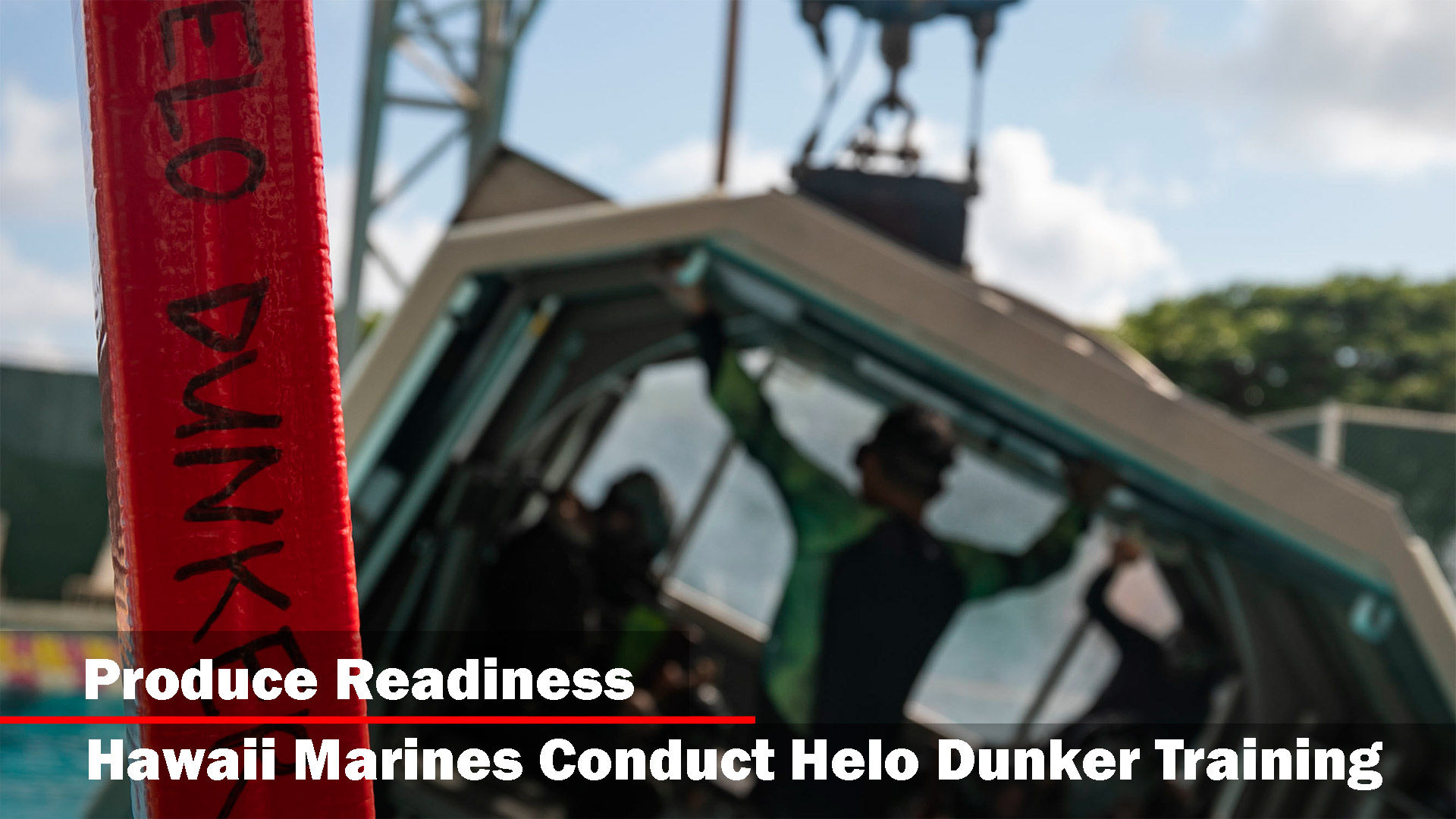 U.S. Marines aboard Marine Corps Base Hawaii prepare to go into the water while conducting helicopter underwater egress training