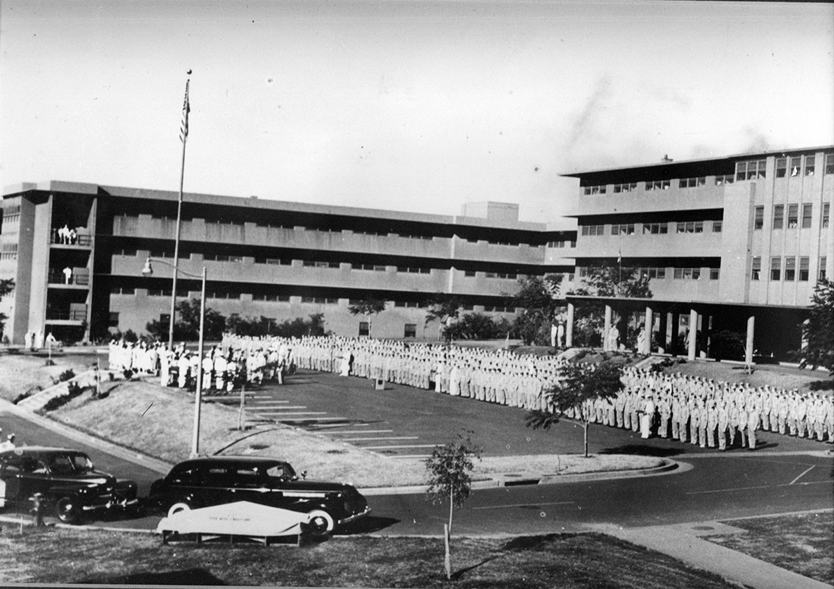All hands formation at Aiea Naval Hospital. On 1 January 1944, Adm. Chester W. Nimitz ordered all able patients to assemble in front of the hospital.